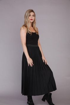 Glam up your wardrobe with this versatile black pleated skirt #fashion #blackskirt #style
