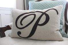 "To make this pillow you will need  1/2 yard of fabric - I chose a yummy oatmeal linen  14"" by 20"" pillow form  1 sheet of felt - I picked a chocolate brown  Felt or Fabric glue  Coordinating thread for fabric and felt  Sewing machine"