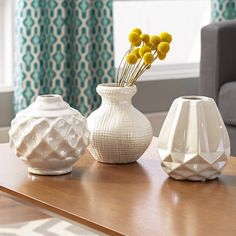 """Features:  -Set includes three vases.  -Ceramic.  -White finish.  Product Type: -Table vase.  Shape: -Bud.  Color: -White.  Primary Material: -Ceramic. Dimensions:  Overall Height - Top to Bottom: -6"""""""