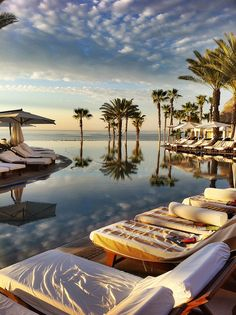 Multiple chaises at a resort poolside. Holiday Destinations, Vacation Destinations, Dream Vacations, Vacation Spots, Romantic Places, Beautiful Places To Travel, The Places Youll Go, Places To See, Cool Pools