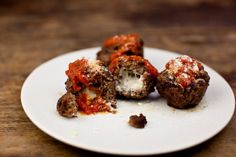 Gojee - Cheese-Stuffed Meatballs Recipe by Food Republic Meatball Recipes, Beef Recipes, Most Popular Recipes, Favorite Recipes, Mozzarella Stuffed Meatballs, Cheesy Recipes, Ground Beef, Cookies Et Biscuits, Chip Cookies