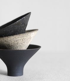 SAKE CUPS...  designed by Kanagawa, Japan based ceramic artist Takashi Endo