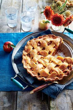 Brown Butter Apple Pie | Browned butter adds a subtle nutty flavor to the crust, and the filling gets a sweet makeover from two types of apples, rich brown sugar, and just the right amount of warming spices. For the best flavor and texture, mix it up: we chose Granny Smith for tartness and Honeycrisp for sweetness. Serve warm with cold vanilla or butter pecan ice cream for the ultimate Southern dessert. Don't be afraid of trying the lattice crust; in just four easy steps you will have the