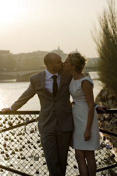 Couple Portrait session in Paris with weddingLight shot at pont des Arts bridge at sunset