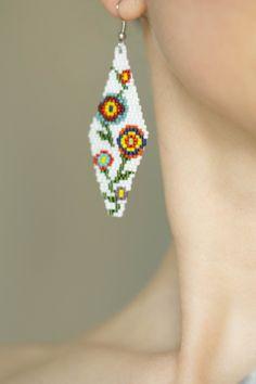 Items similar to Colorful flower earrings - Beaded jewelry - Women gift - Black seed bead earrings - Floral jewelry - Woven beads earrings - Clip on earrings on Etsy Beaded Earrings Patterns, Seed Bead Earrings, Fringe Earrings, Unique Earrings, Diy Earrings, Flower Earrings, Beaded Jewelry, Hoop Earrings, Seashell Crafts