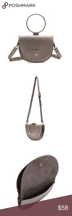 "Premium vegan leather handbag Premium vegan leather Melie Bianco crossbody handbag.  Front flap magnetic clasp closure. Removebable crossbody strap included - wear it by the ring only if wanted! Fits up to an iPhone 7 plus. Dimensions 8"" L x 5"" W x 6.2"" H. Melie Bianco Bags Crossbody Bags"