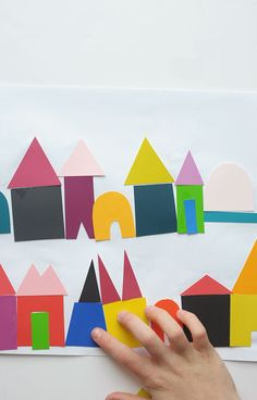 Grab some paint chip samples, some scissors and glue and let your kid's imagination run wild with this DIY Paint Chip City Art tutorial!