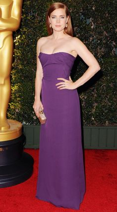 AMY ADAMS At the Governors Awards, Amy Adams dazzled in a strapless purple Vivienne Westwood gown. She accessorized with Irene Neuwirth jewelry and an Edie Parker clutch.