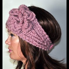 """Handmade Crocheted ear warmer- bottom image Keep your ears warm in this cute handmade crocheted item! Purple color base with accents of grey, pink, and purple. Wood button closure. Approximately 20 inches long, 5 inches at its widest. Flower is 4"""" x 4"""". Never worn, brand new. Accessories Scarves & Wraps"""