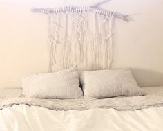 This rectangular shaped headboard wall hanging was hand knotted with love on a piece of driftwood found along the coast of California and designed