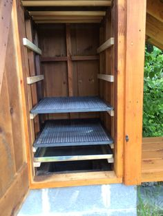 The Smokehouse Part 4 – shelves – Confessions of a fisherman, hunter and tinkerer Smoke House Plans, Smoke House Diy, Build Your Own Smoker, Fish Smoker, Bbq Shed, Diy Outdoor Kitchen, Outdoor Cooking, Wood Smokers, Offset Smoker
