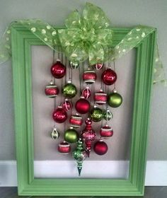 This is definitely an unexpected wreath. You can use any wood frame and paint it the color of your choice, then just add complimenting ornaments. Diy Christmas Decorations Easy, Christmas Ornaments To Make, Christmas Diy, Christmas Wreaths, Holiday Decorating, Xmas, Picture Frame Wreath, Christmas Picture Frames, Picture Frame Crafts