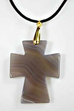 Check out this item in my Etsy shop https://www.etsy.com/listing/225020694/agate-cross-pendant-necklace-gray-carved