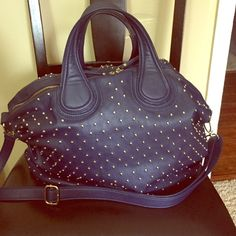 Blue Studded Handbag Handbag has gold studs. However a few of them has fell off. Good condition. Imoshion Bags Satchels