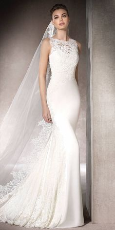 Mermaid wedding dress in soft satin combined with lace and guipure appliqués. Sweetheart and crew necklines and a low back create a stylish, very romantic silhouette.