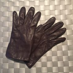 Buttery soft brown leather gloves Size M-L. Excellent condition. These go well with the orange or tan winter coats I have listed. You will seriously love these! Isotoner Accessories Gloves & Mittens