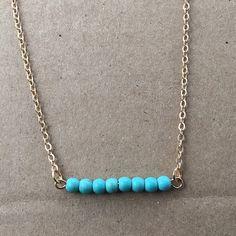 """Simple Turquoise Bar Necklace Delicate Turquoise Necklace. Genuine Turquoise Stone Beads are suspended on delicate chain. Minimal and classic with a pop of striking color.  Necklace: """"Long Turquoise Beaded Bar""""  - 14k Gold Fill, wire and findings - Delicate, high quality Italian or USA made components - Genuine Turquoise stones Ninety 8 North Co.  Jewelry Necklaces"""