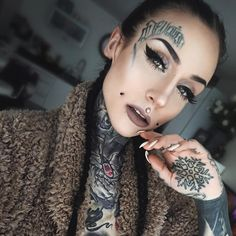 Selfie photo by pretty tattooed and inked model Monami Frost