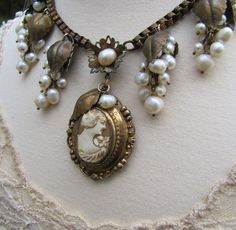 Genuine Shell Cameo- Refashioned Vintage Pendant Necklace- Freshwater Pearls, Antique Brass Leaves-  Statement Necklace- Under the Bower. $155.00, via Etsy.