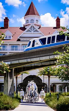 Three Walt Disney World classics - Cinderella's Coach, the Grand Floridian Resort and a blue monorail