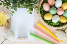easter eggs and other decorations on wooden background