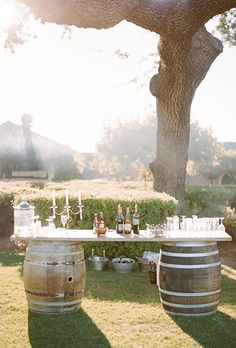 Brides.com: . To complement their vineyard venue, this couple built a bar out of vintage wine barrels.