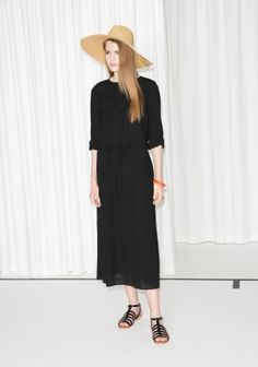 Made from lightweight cotton crepe, this breezy ankle-length dress features long sleeves and a drawstring waistline.