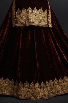 From our Bridal Heritage Collection, this is a burgundy silk velvet lehenga outfit adorned with exotic Kashmiri Gold Tilla embroidery on lehenga, shirt and dupatta. Designer Dress For Men, Indian Designer Outfits, Indian Outfits, Designer Dresses, Embroidery Suits Punjabi, Embroidery Suits Design, Hand Embroidery, Embroidery Designs, Kurti Neck Designs