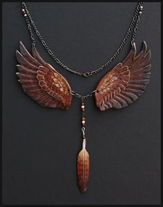 Not as a necklace, but I love the wings, and the feather. :) // Royal Gryphon Leather Necklace .. By *Windfalcon*