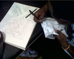 IN ACTION - Thabiso freehand drawing designs on sneakers