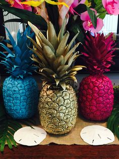 Spray paint/ fresh pineapples/ spray painted fruit/ magenta/ sea blue/ gold/ luau party decor