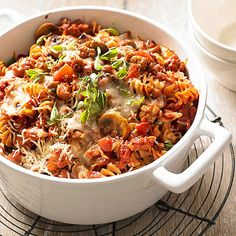 Whole grain rotini adds heart-healthy fiber to this simple baked pasta recipe while turkey sausage keeps it low in fat. But don't let its health benefits distract you: The pasta bake is packed with cheesy goodness and rich Italian flavors. Sausage Pasta Recipes, Baked Sausage, Casserole Recipes, Turkey Sausage, Beef Pasta, Pasta Pizza, Pasta Bake, Easy Weeknight Meals, Easy Meals