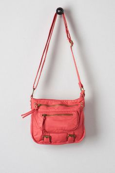 """Add a cute bag to your look with the Peoria Washed Buckle Crossbody. This soft faux leather bag features double zipper pockets along the front. Finished with burnished buckle details and an interior zipper pocket. Pair with an embroidered top and sandals for the perfect look. <br><br>    - 9.5"""" width x 8"""" height x 2"""" depth<br>  - 21"""" adjustable strap drop<br>  - Imported<br>"""