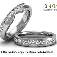 Fitted wedding rings made to fit with an engagement ring, one with a straight row of diamonds and the other with a curved row.
