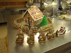 Gingerbread house with Santa and reindeer by LizzyLix.deviantart.com on @deviantART