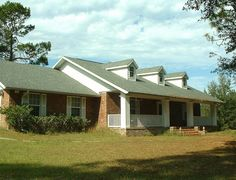 Front of 3 Bedroom, 3 Bath Room House, 6459 Southeast County Road 337, Newberry, FL 32669.  Home For Sale on 5 acres, 3 Bedrooms, 3 Baths, 2 Car Garage, Workshop, Out Building, Shed.  #HomeForSale  #HouseForSale  #3Bedroom  3#Bath  #NewberryFL  #GainesvilleFL  #5acres  #GilchristCounty  http://www.eyemarkrealty.com/