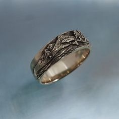 This actually is a picture of Mt. Jefferson with a world famous trout river at its base. If you are a fly fisherman, you probably will know it.  This ring is 9mm wide at the top. It tapers to 6mm at the bottom. It features detailed carving. And this ring is made in sterling silver. Price listed is for finger sizes to 11, and we can go larger by quote. Please let me know what size you wish, on the order page, where you can leave a message to seller. I make these one at a time, to your finger…
