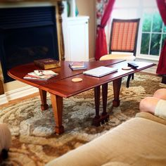 Repurposed baby grand piano lid made into a coffe table