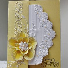 Blingy Flower - love this flower on the soft yellow paper, embossed in white.  Flower stamp by Stampendous