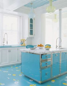 from House of Turquoise....love all the blue with white...island, ceiling, lights...cute!!