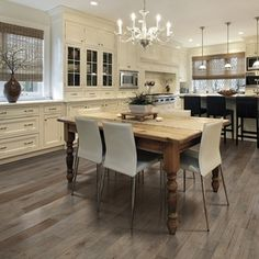 These grey hardwood floors from the Columbia Wimberly collection have a unique color variation that includes light and dark visuals combined with tan for a warm look. Available in a wide 5 inch plank.