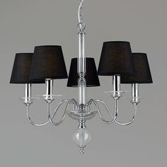 Chandelier ~ Modern style 5 light chandelier with small black shades to conceal the candle light bulbs.  Beautiful soft & efficient lighting.