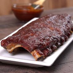 Baked BBQ Ribs whole rack with sauce on platter