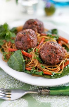 Gluten-Free Turkey Meatballs Recipe with Lime, Mint and Ginger on a bed of Asian Style Noodles, Baby Spinach and Fresh Herbs, from Gluten-Free Goddess