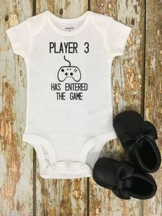 This is bodysuit makes the perfect pregnancy announcement for all the expectant parents who love to play video games! ** Moccasins NOT included!**