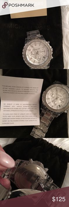 Michael Kors     semi precious watch Michael Kors rare, authentic large watch with semi precious crystals surrounding a silver setting and clear acrylic band. Silver closure and multi link band to adjust size. Accessories Watches