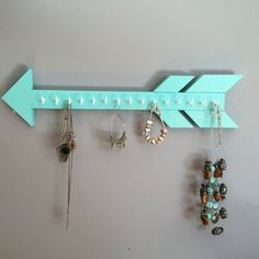 A simplistic, trendy way to organize your jewelry. This arrow offers a safe method for storage of your favorite necklaces -Solid Wood & handmade -20 tip to tail -approx 4 tall -many colors available -Fifteen (15) white or gold hooks for jewelry hanging Perfect Gift Idea! *hanging hardware included with item* --------------- Pictured Colors: teal, salmon, lavender, mauve (out of stock) --------------- Your item will be ready to ship in 3-5 days. I will ship this USPS Ground Service 2...