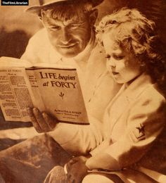 Will Rogers reads to Shirley Temple