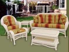 All white Empire patio furniture by Schober Company.