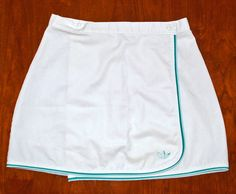 vintage tennis skirt 70's wrap adidas trefoil logo 30 waist short sporty. $22.00, via Etsy.